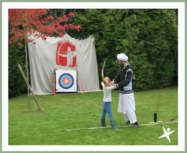 archery lesson at the little explorers